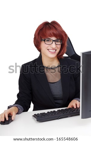 Woman working on computer - stock photo