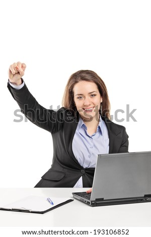 Woman working on laptop and gesturing success isolated on white background - stock photo