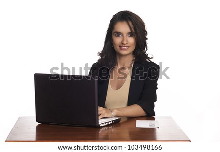 Woman working on laptop computer - stock photo
