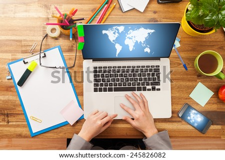 Woman working on laptop with digital screen. Shot from above view - stock photo
