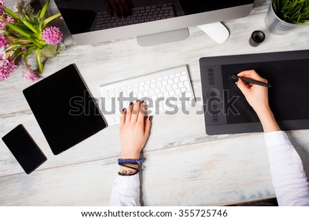 Woman working on modern technology  - stock photo