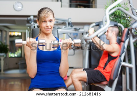 Woman working out in a fitness club - stock photo