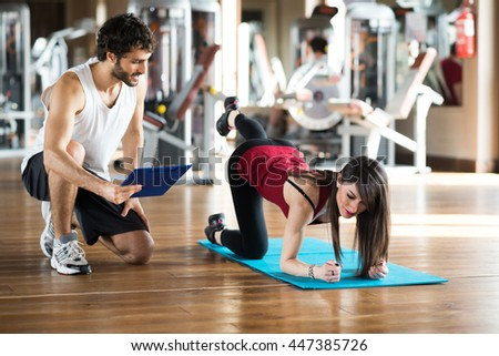 Woman working out on a gym - stock photo