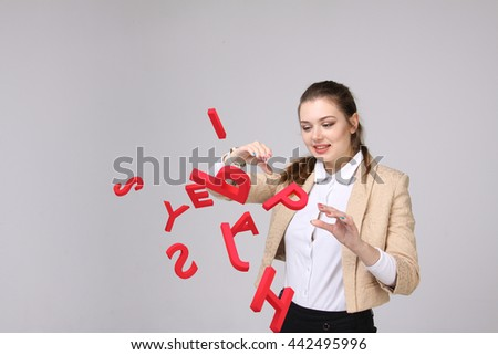Woman working with a set of letters, writing concept. - stock photo