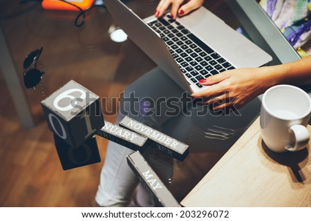 woman Working with Her Laptop - stock photo