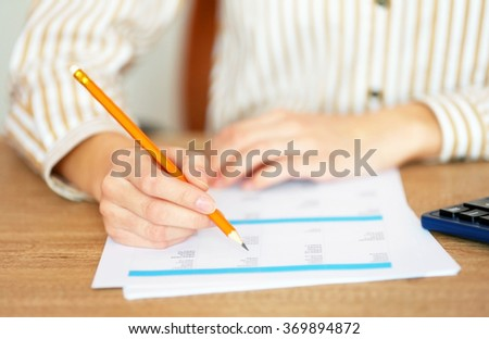 Woman working with papers at the table