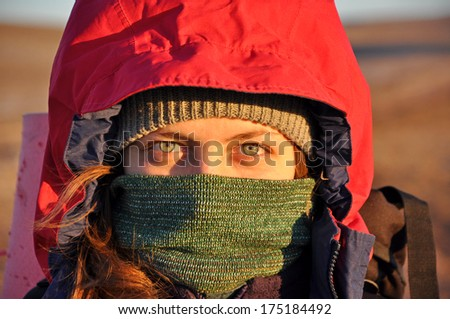 woman wrapped face from a cold - stock photo