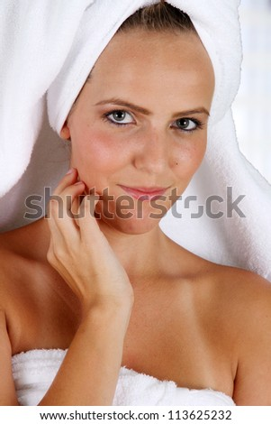 Woman wrapped in a towel while at spa - stock photo
