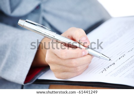 woman write by pen on paper - stock photo