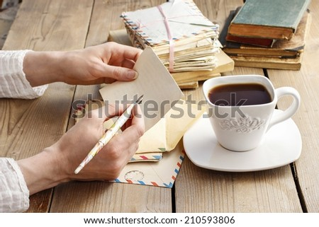 Woman writing a letter - stock photo