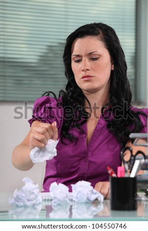 woman writing and crumbling papers - stock photo