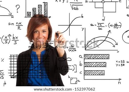 Woman writing formulas on the screen - stock photo