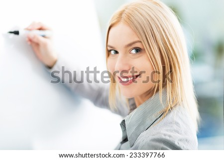 Woman writing ideas on adhesive notes  - stock photo