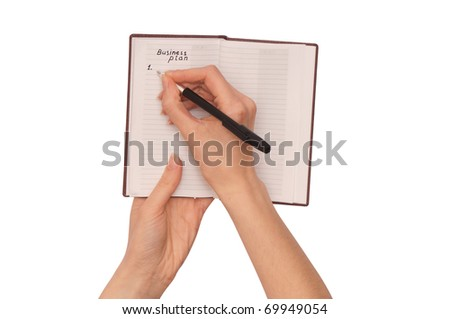 woman writing notes and ideas for business plan - stock photo