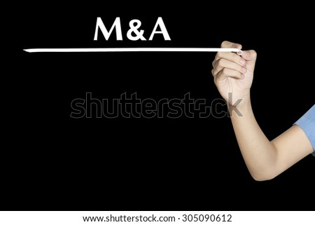 Woman writing word M & A (Merger and Acquisition) with black screen - stock photo