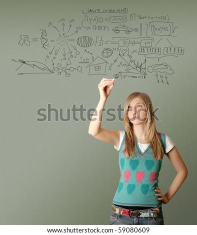 woman writting something isolated on gray background - stock photo