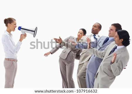 Woman yelling at co-workers through a megaphone against white background - stock photo