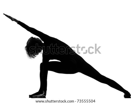 woman yoga posture Extended Side Angle Pose position in silouhette on studio white background