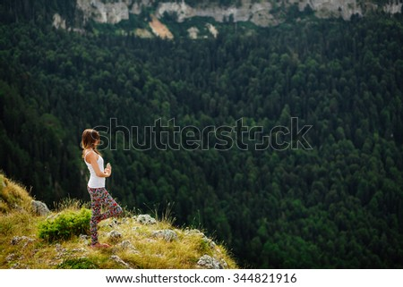 woman yoga relax at the end of earth in fascinating landscape in Montenegro - stock photo