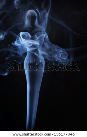 Womanish image made of fume