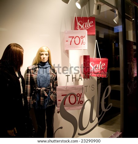 Womans Clothing Store Window In Sale Season. Shopping Series. - stock photo