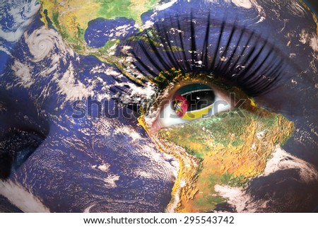 womans face with planet Earth texture and mozambican flag inside the eye. Elements of this image furnished by NASA. - stock photo