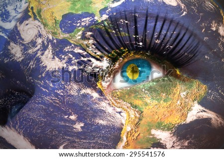 womans face with planet Earth texture and palau flag inside the eye. Elements of this image furnished by NASA. - stock photo