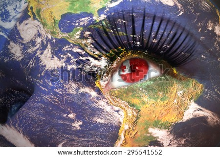 womans face with planet Earth texture and tonga flag inside the eye. Elements of this image furnished by NASA. - stock photo