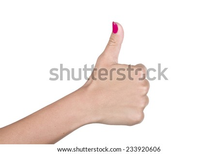 Womans hand making sign one with thumb up - stock photo
