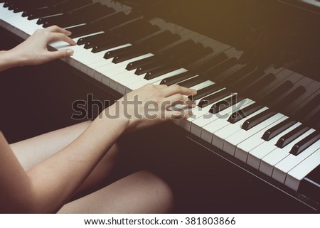 womans hands playing piano/ selective focus - stock photo