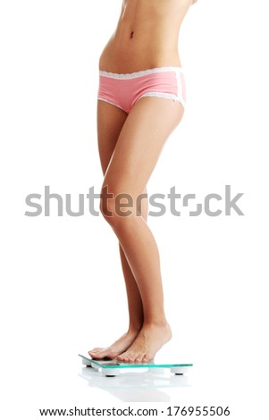 Womans legs, weight loss, isolated on white.  - stock photo