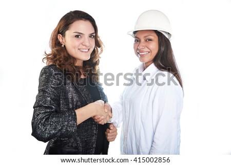 womans partnership handshake engineer and architect isolated - stock photo