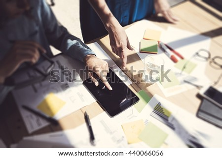 Womans Touching Display Digital Tablet Hand.Project Managers Researching Process.Business Team Working Startup modern Office.Analyze market stock.Using electronic devices,paper,note wood table.Blurred - stock photo
