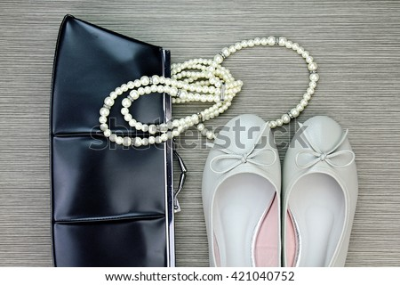 Women accessories, Still life of fashion woman. Overhead of essentials fashion woman objects, Purse, Necklace, Women leather shoes. - stock photo
