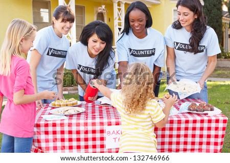 Women And Children Running Charity Bake Sale