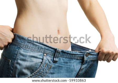 Women and jeans of the greater size. The concept of growing thin. It is isolated on a white background - stock photo