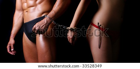 women and man with handcuffs - stock photo