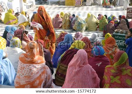 women at pushkar lake - stock photo