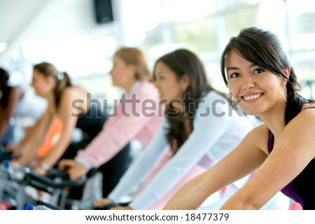 women at the gym doing cardio exercises - stock photo