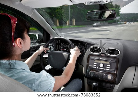 women at the wheel the car ... - stock photo