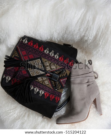 women bag and shoe on a composition in pan on a background like carpet