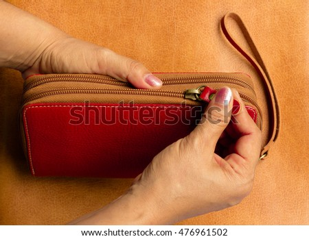 Women bag is opened by hand
