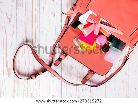 Women bag with cosmetics with medicine condoms .Save sex concept - stock photo