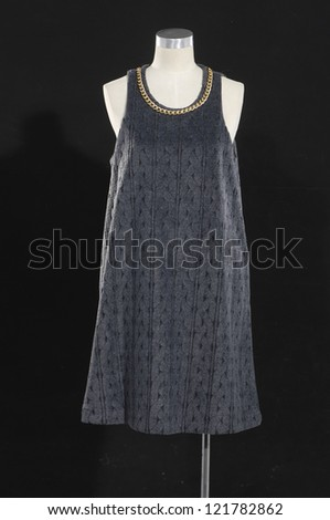 Women beautiful dress on mannequin on black e background