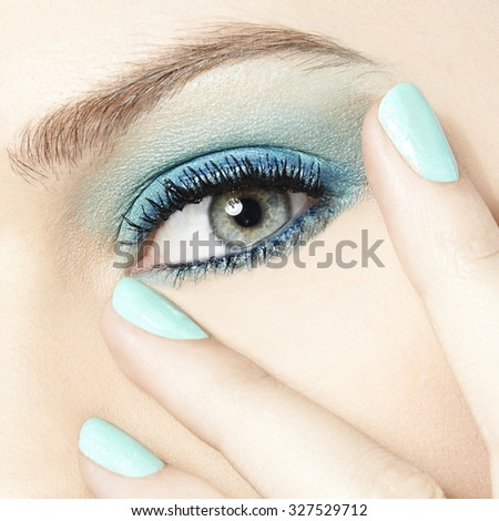 women beauty close up eyes with blue make up and blue nails - stock photo