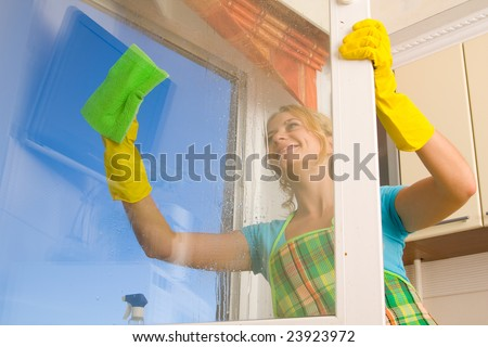 Women cleaning a window 4 - stock photo