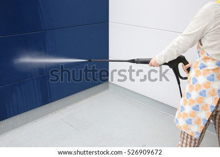 Women cleaning walls