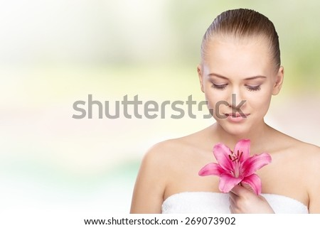 Women. Close-up of a young woman with red flower - stock photo