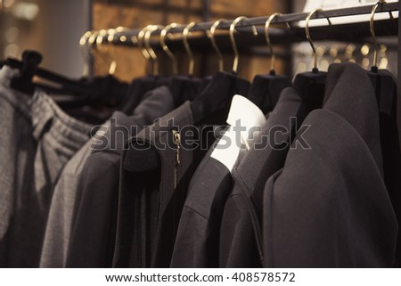 Women clothing  in a retail shop. Fashion and shopping concept.