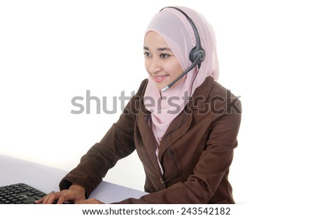 Women customer service officer smiling while wearing headset and typing isolated on white background - stock photo